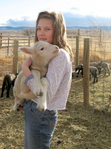 Ella-holding-Targhee-sheep